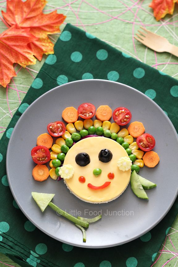 a cute red indian native american sandwich with a cucumber arrow cheese bread and veggies turn into a fun meal