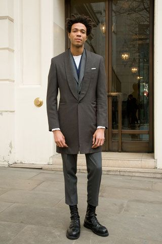 Charley Casely-Hayford Fashion Designer Wearing: Homme overcoat. Army  surplus boots. Everything