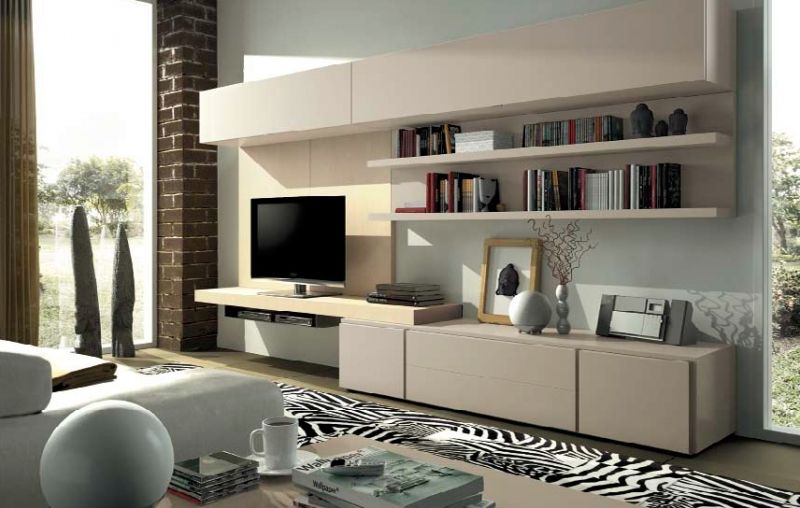 Liviano salón comedor con amplia zona de almacenaje y librería de ...