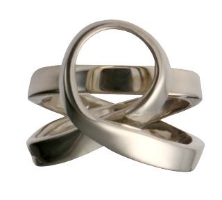 """Like milk and honey the design of this hand made silver ring is flowing and sweet. """"Love"""" is delicately engraved by hand on the inside band for an intimate finishing touch."""