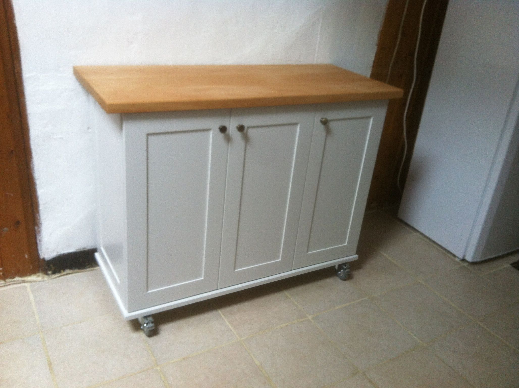 free standing kitchen island cabinet on casters by andre hodges