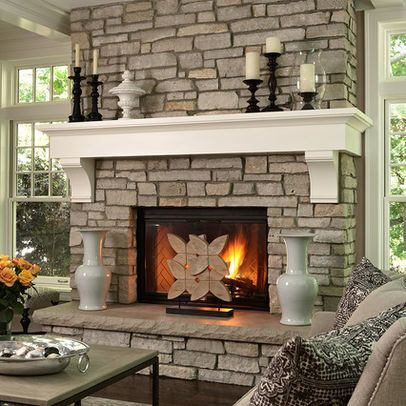 Stone fireplace with white crown molding mantel Nesting