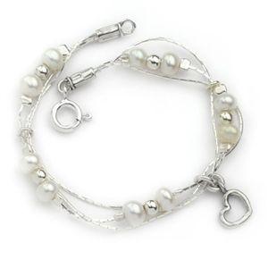 Fabulous designer pearl bracelet. http://www.oghamjewellery.com/Sterling-Silver-Pearl-Bracelet-ASB354-p/asb354.htm