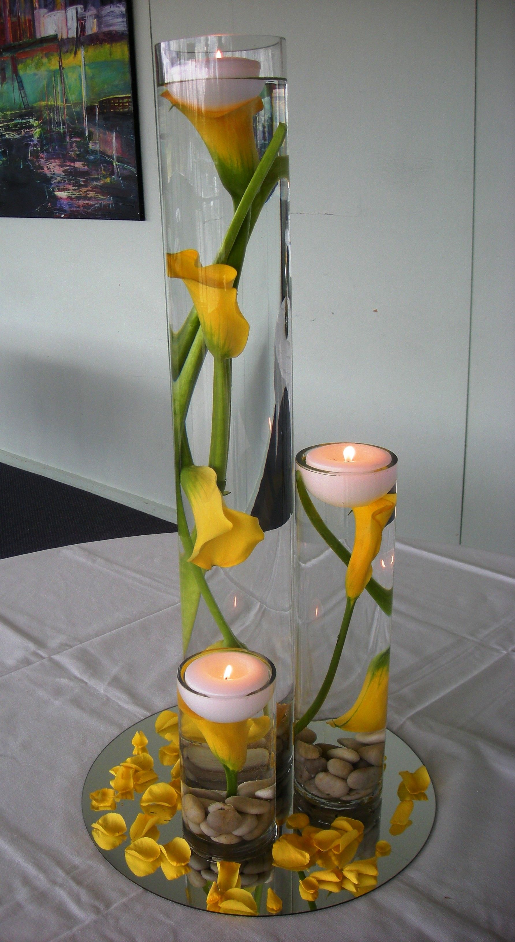 Stunning yellow calla lily center pieces i would add for Black table centrepieces