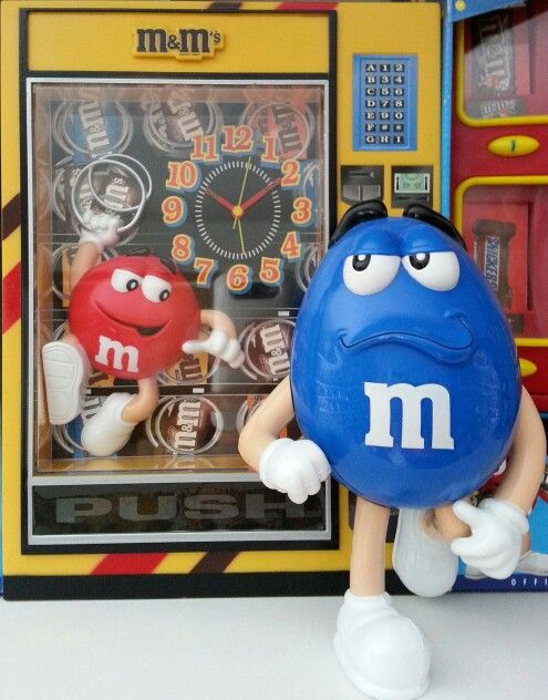 """Blue outside of """"candy vending machine"""" with red inside: dispenser"""