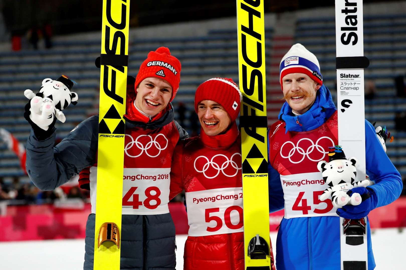 2018 Winter Olympics Gold Medal Winner Kamil Stoch Of Poland Is Flanked By Silver Medal Winner Andreas Wel Winter Olympics 2018 Winter Olympics Ski Jumping