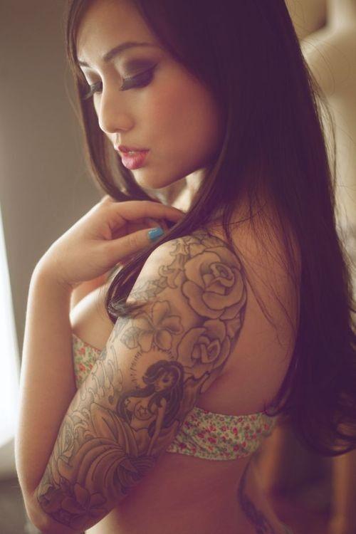 Asian tattooed woman