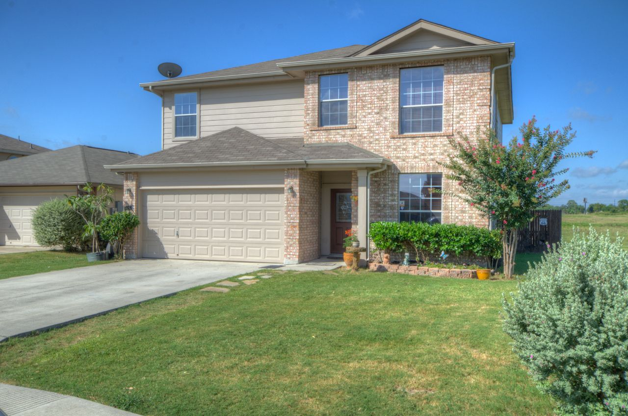 2118 Dodge Drive, New Braunfels, TX 78130 - Warm and inviting home located in Comal ISD. Ideally set on a spacious greenbelt lot; enjoy sunsets in the large back yard w/ a covered patio, & a large empty lot on the right. Open floor plan w/ high ceiling throughout. Multiple dining spaces great for office or family room. Custom tile backsplash, stainless appliances, double oven range, large walk-in panty & plenty of granite counter space.