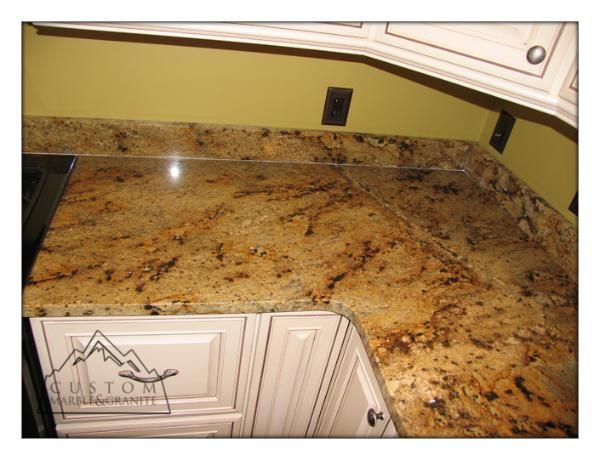 Golden Crystal granite and white cabinets