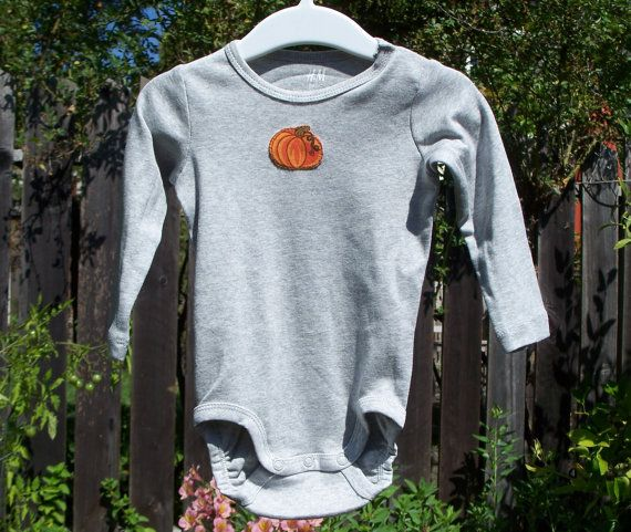 Grey long sleeve bodysuit with your choice of applique.  4-6M, 6-9M, 9-12M or 12-18M  $18