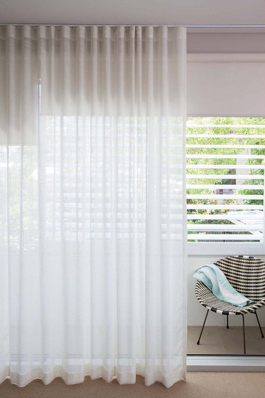 Stunning Sheer White Linen Curtains Overlaying Sleek Helioscreen Bloc Out Roller Blinds Plantation