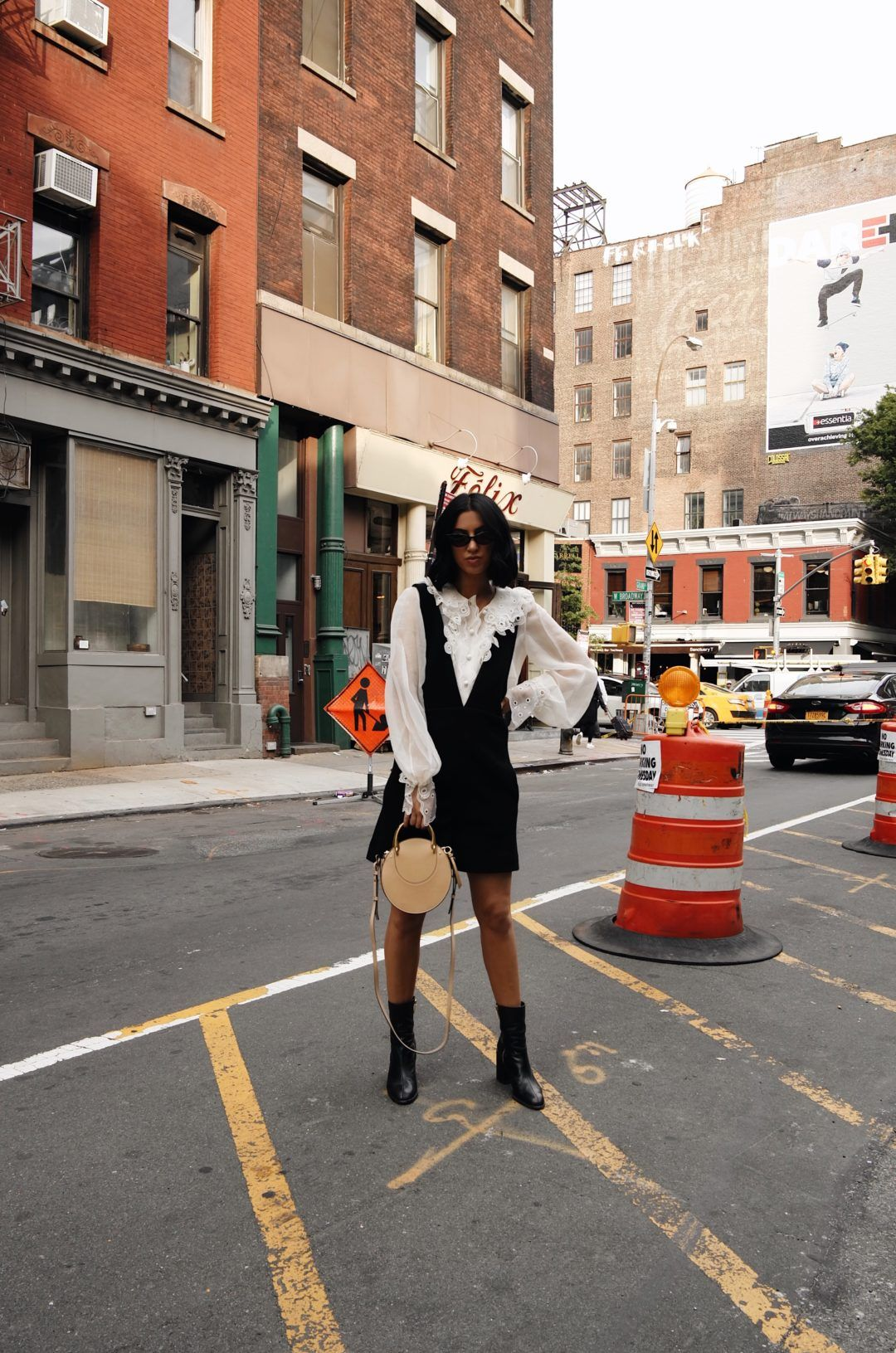 dfb701ba1e99 LA Blogger Tania Sarin in New York for NYFW wearing Chloe ruffle top and  sunglasses featuring Dear Frances boots.