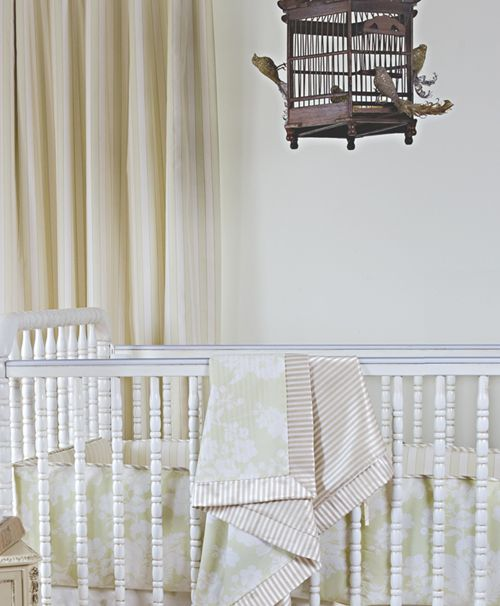 The bird cage mobile is unexpected and delicate.#mobile #nursery