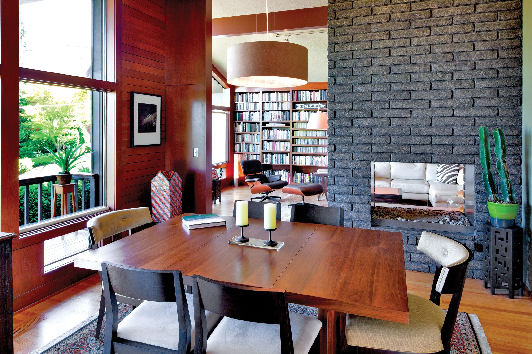 the two sided gray stained masonry fireplace is situated between