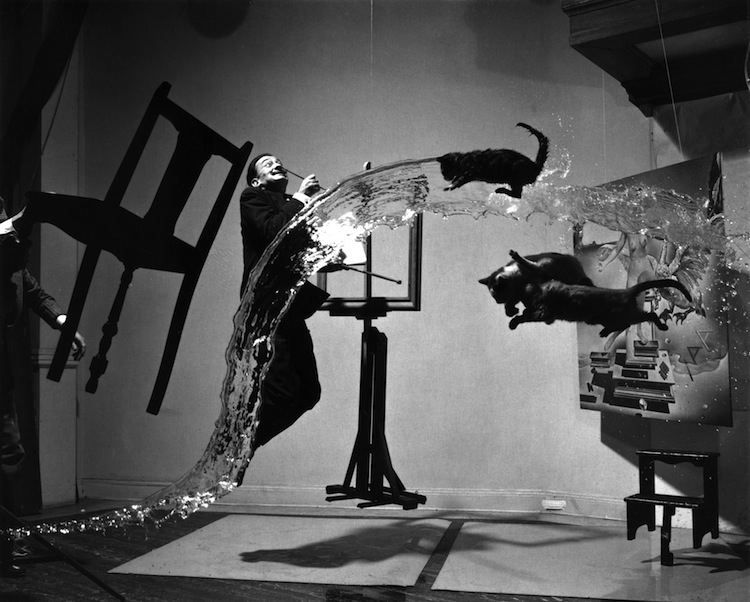 "Dalí Atomicus, 1948-This surreal image was taken by Philippe Halsman as homage to both the new atomic age and to Salvador Dali's surrealist masterpiece ""Leda Atomica"". The bizarre photograph is actually a combination of people jumping and water and cats being thrown. The shoot took six hours, 28 jumps and various assistants throwing things in the air."