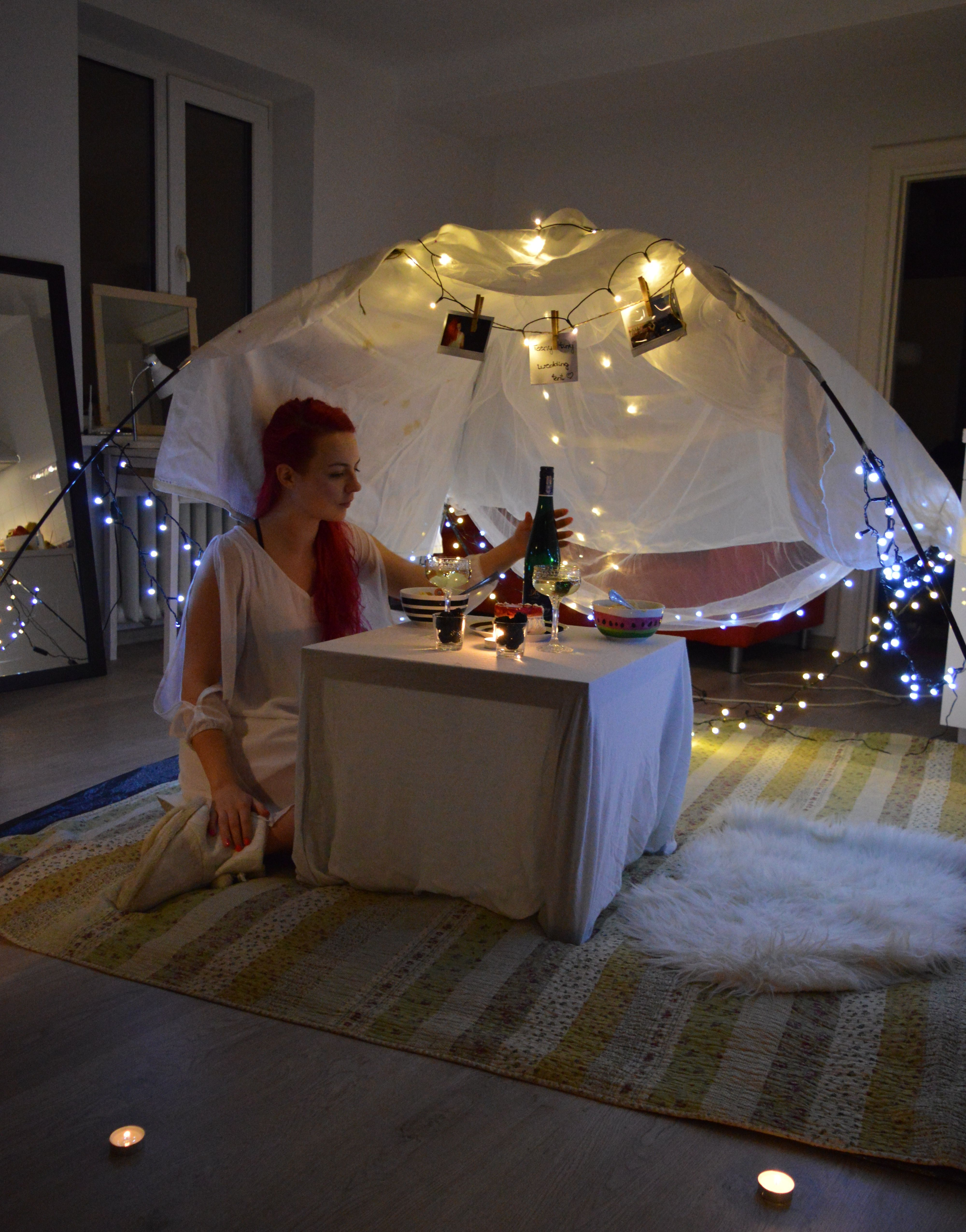Make larger cut outs of the heart shaped paper and string then down from the ceiling to make it look even prettier. Cozy romantic surprise birthday dinner in the tent at home