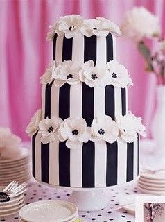 Black and White #wedding #cake. The simple design makes it very dramatic. Lady Marmalaide loves this. For your perfect wedding gown visit www.ladymarmalaide.com / www.demetriosbride.com. Wholesale wedding dresses Africa