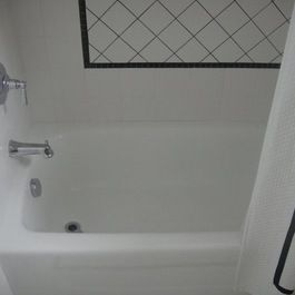 Bathroom Remodel With Light Color Scheme And Black Glass Accents By - Hatchett bathroom remodel