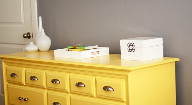 These grey walls with yellow furniture might be a better way for me