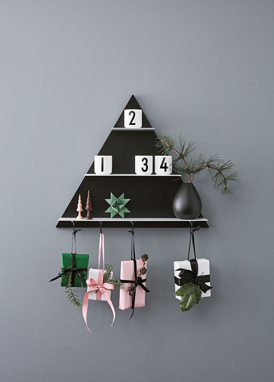 Turn Triangle Paper Shelf into a Christmas decoration in December with only a few items. Gifts on our magnetic Tool Hook, mini porcelain cups with candle lights, AJ Royal Vintage vase in black and some favorite Christmas ornaments.