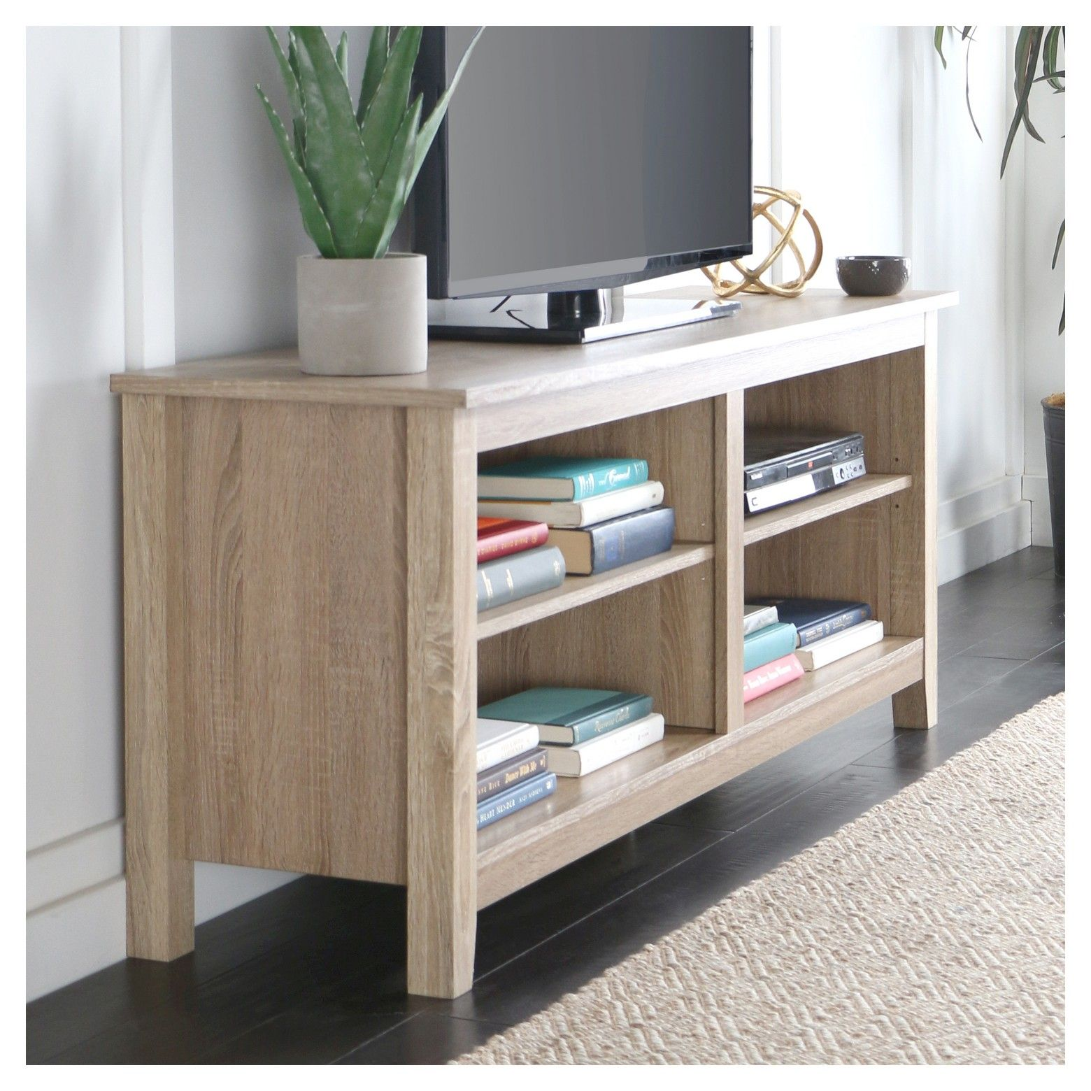 Display your TV in style with this wood media stand Crafted from