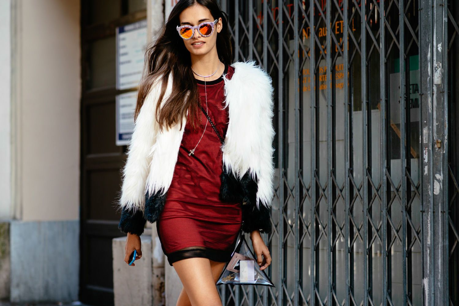 Black and white faux fur coat and red mini dress