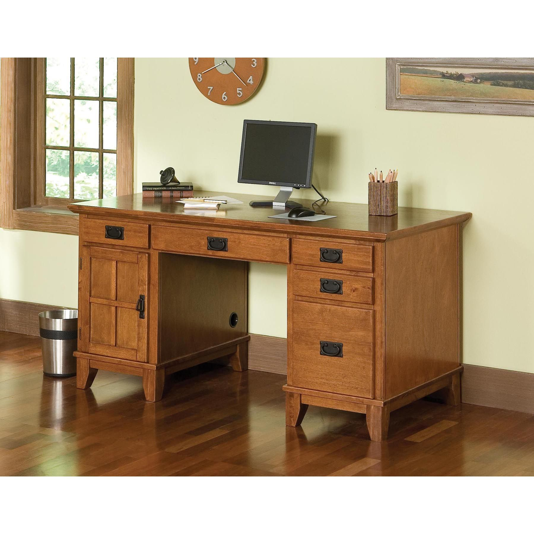 Enhance the decor of your home or office with this oak pedestal desk