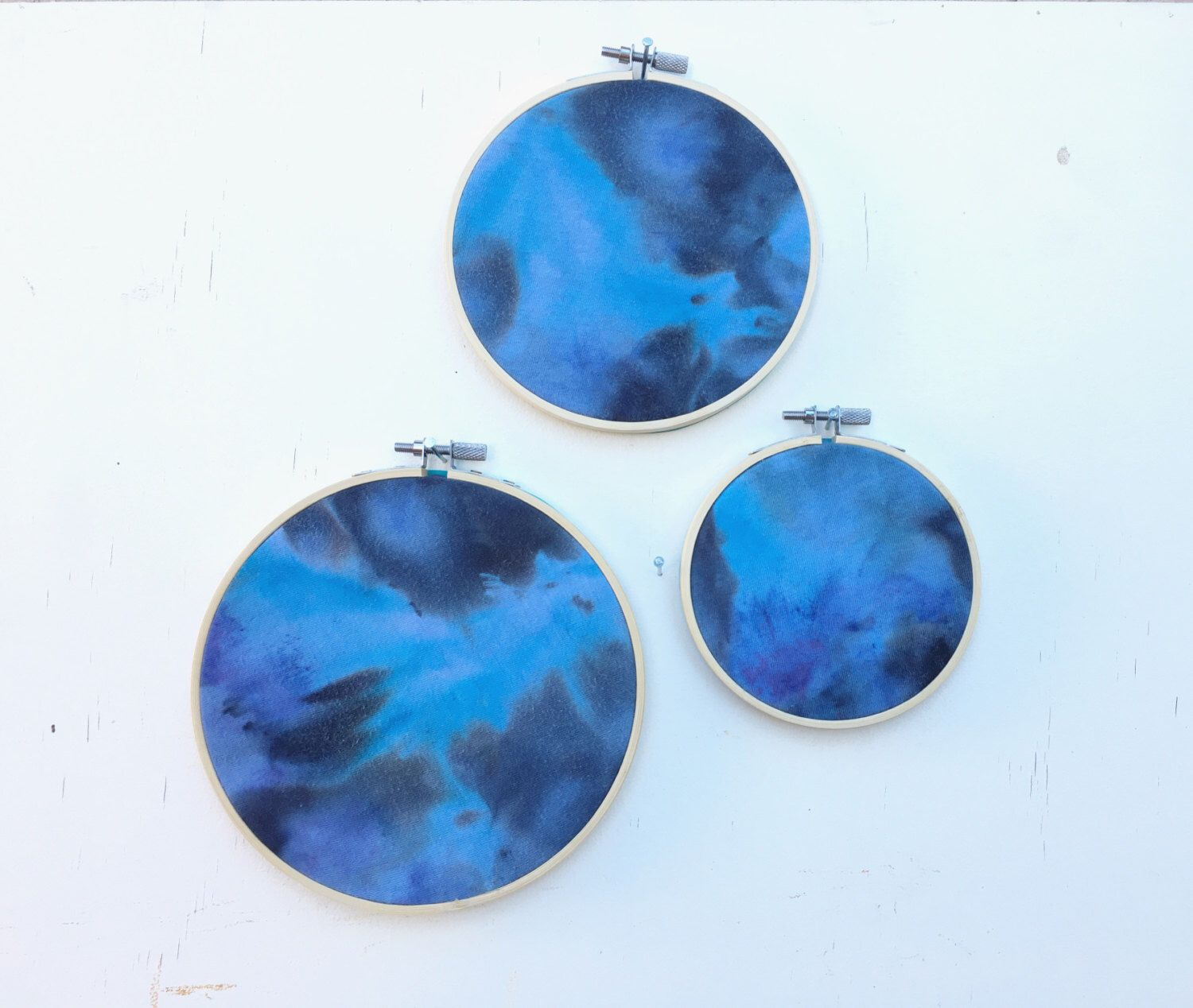 A personal favorite from my Etsy shop https://www.etsy.com/listing/478132746/hand-made-wall-art-embroidery-hoops-set