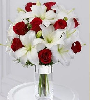 red roses and white lilies wedding flower bouquet, bridal bouquet, wedding flowers, add pic source on comment and we will update it. www.myfloweraffair.com can create this beautiful wedding flower look.