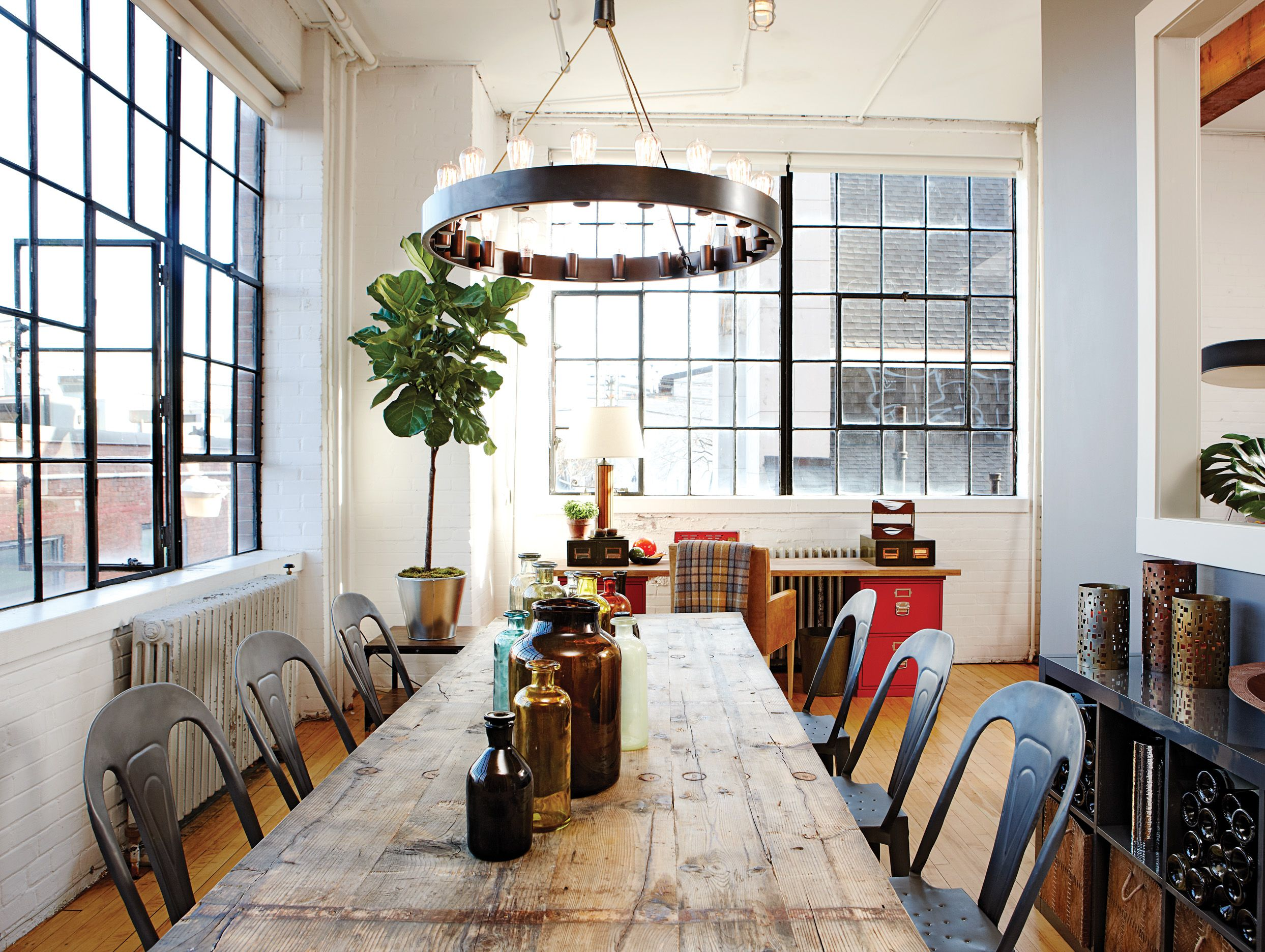 A Giant Table Made From Reclaimed Wood Takes Centre Stage In This Dining Area