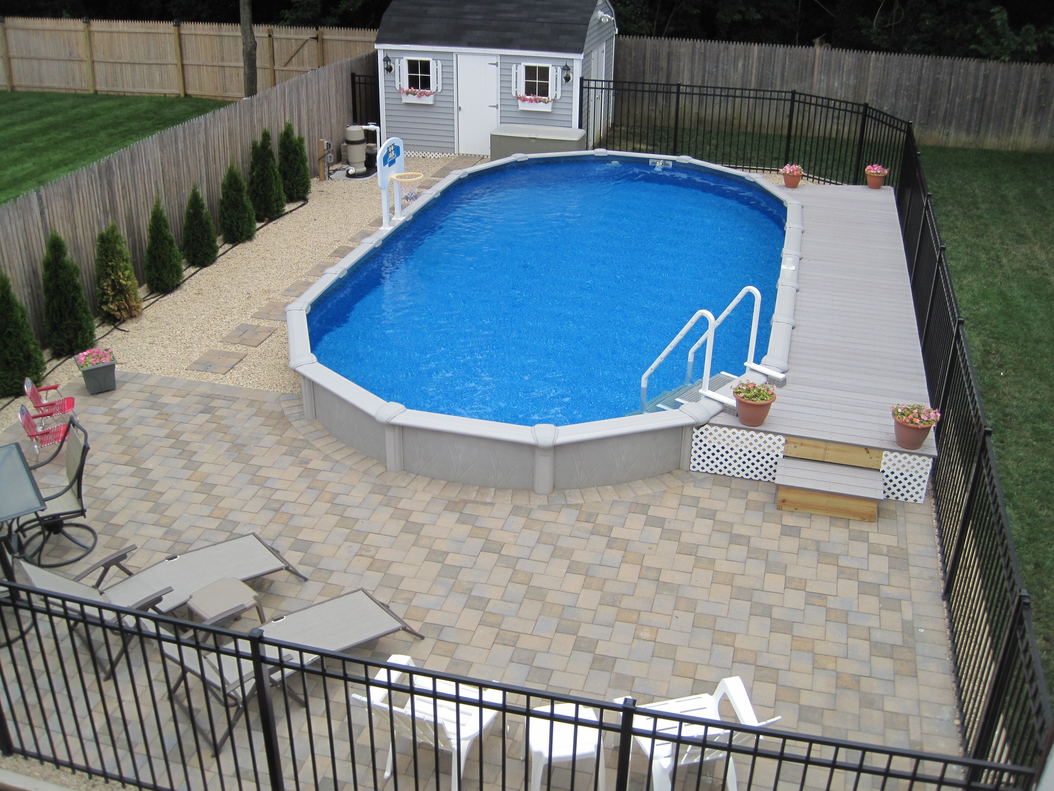 15x30 Sharkline Semi Inground Pool With Deck And Pavers Above