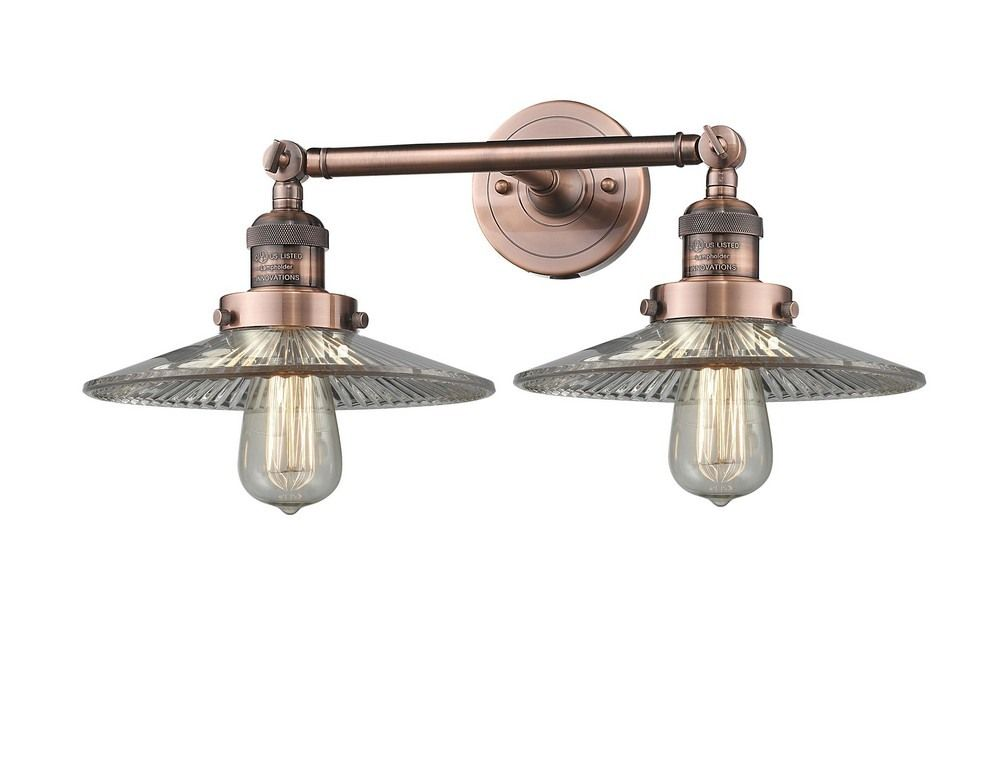 Photo of Two light antique copper finish wall lights with halophane glass