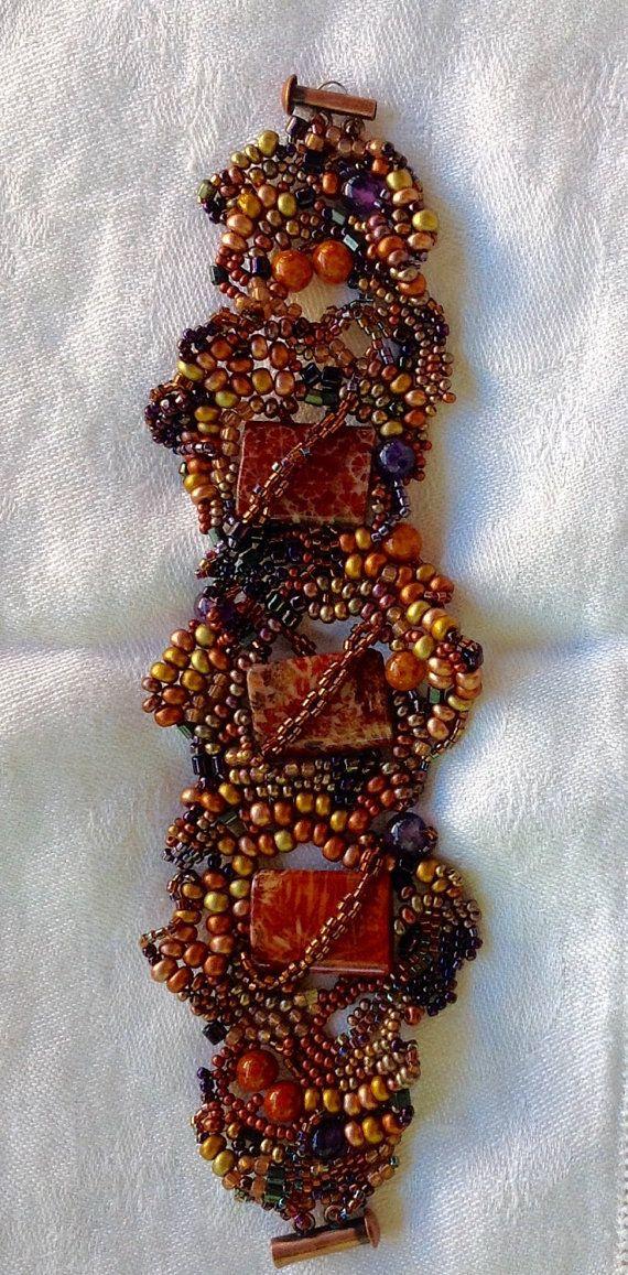 Shimmering free form beaded bracelet surrounding red by JudesArt
