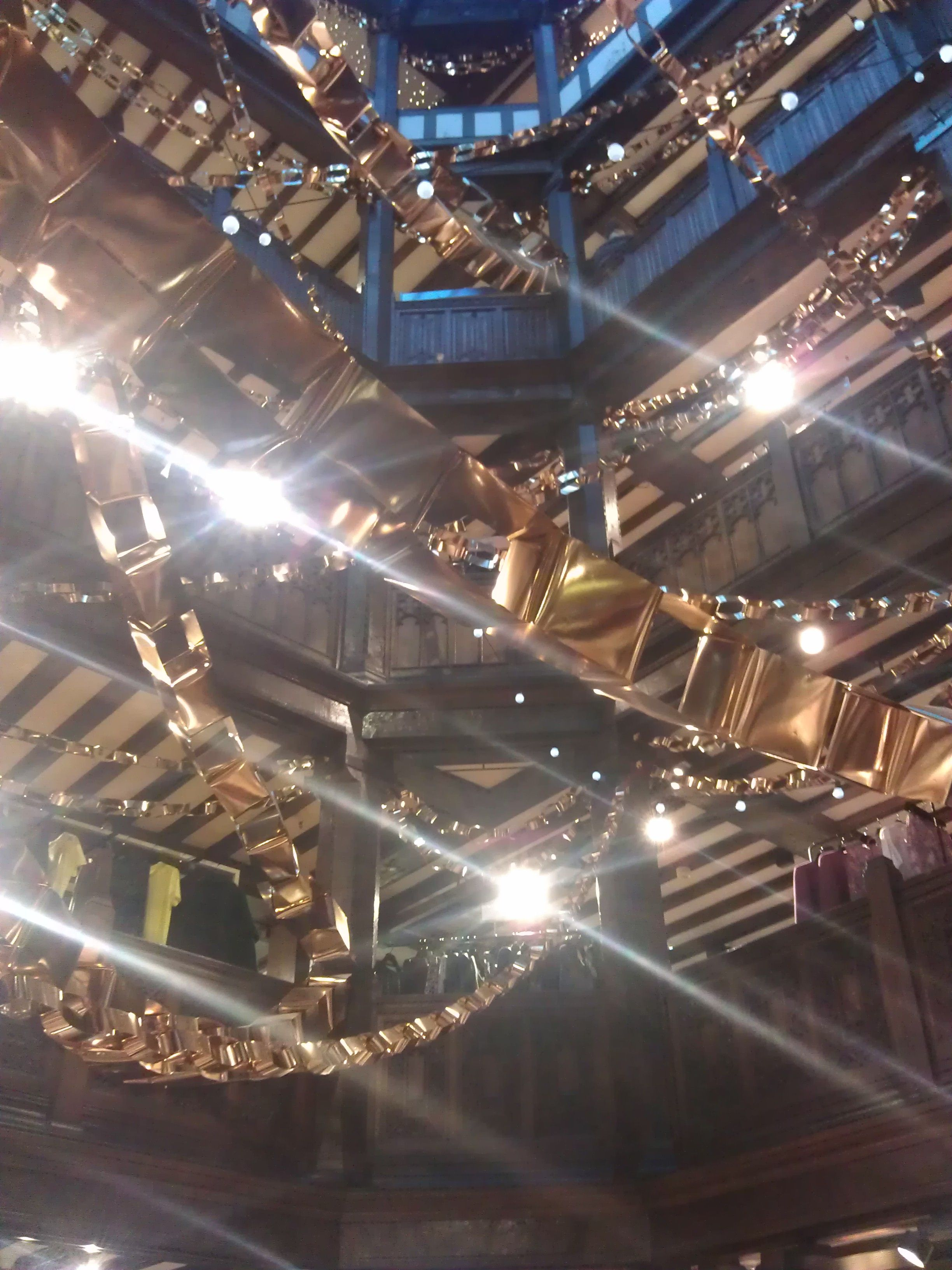 Giant gold paper chains at Liberty Tour Moodboard