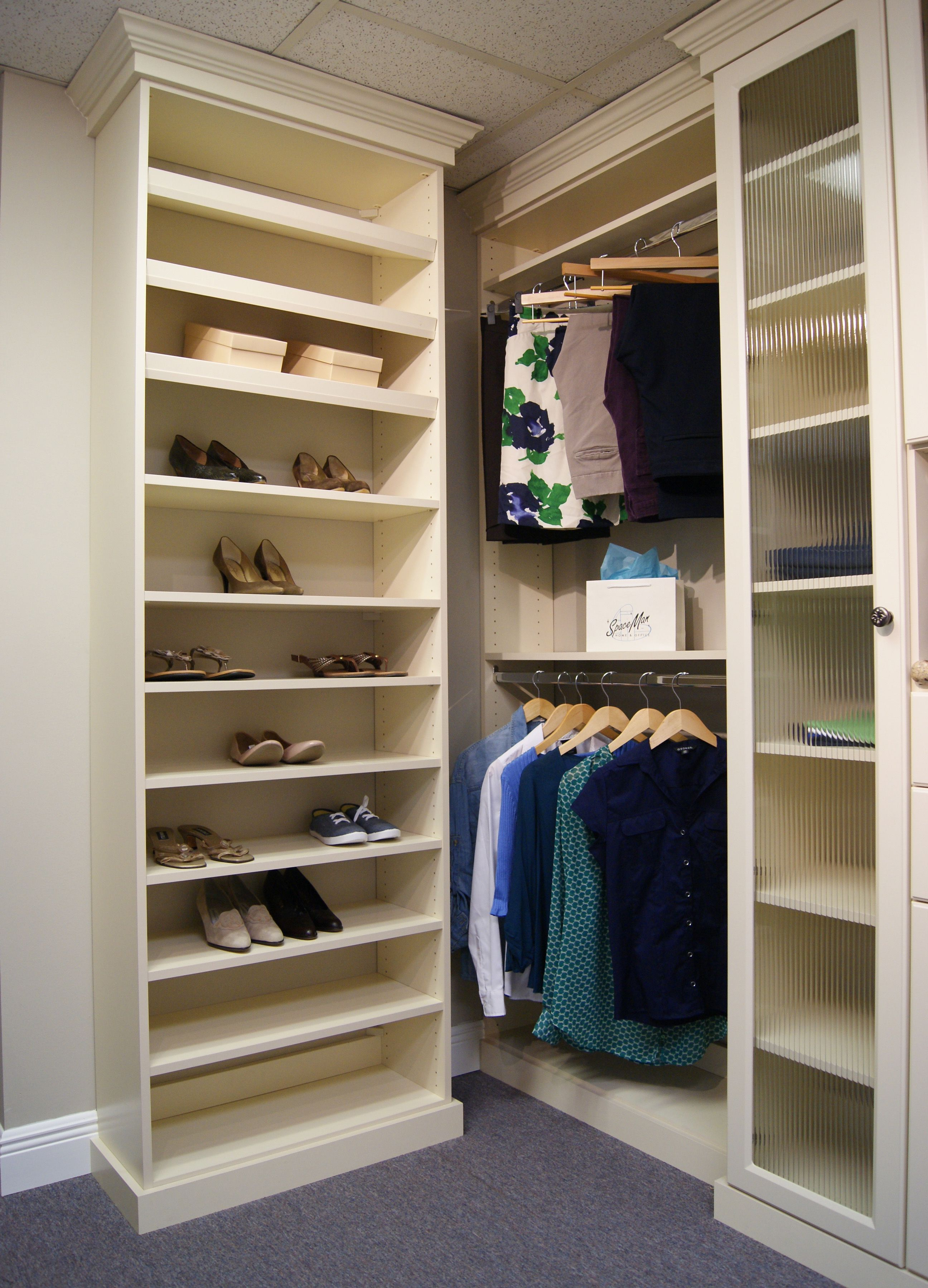 Shoe shelving in this custom closet includes a bination of