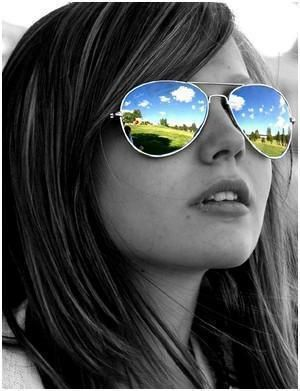 One of my favorite pictures is a black and white with mirrored sunglasses of my nephew...