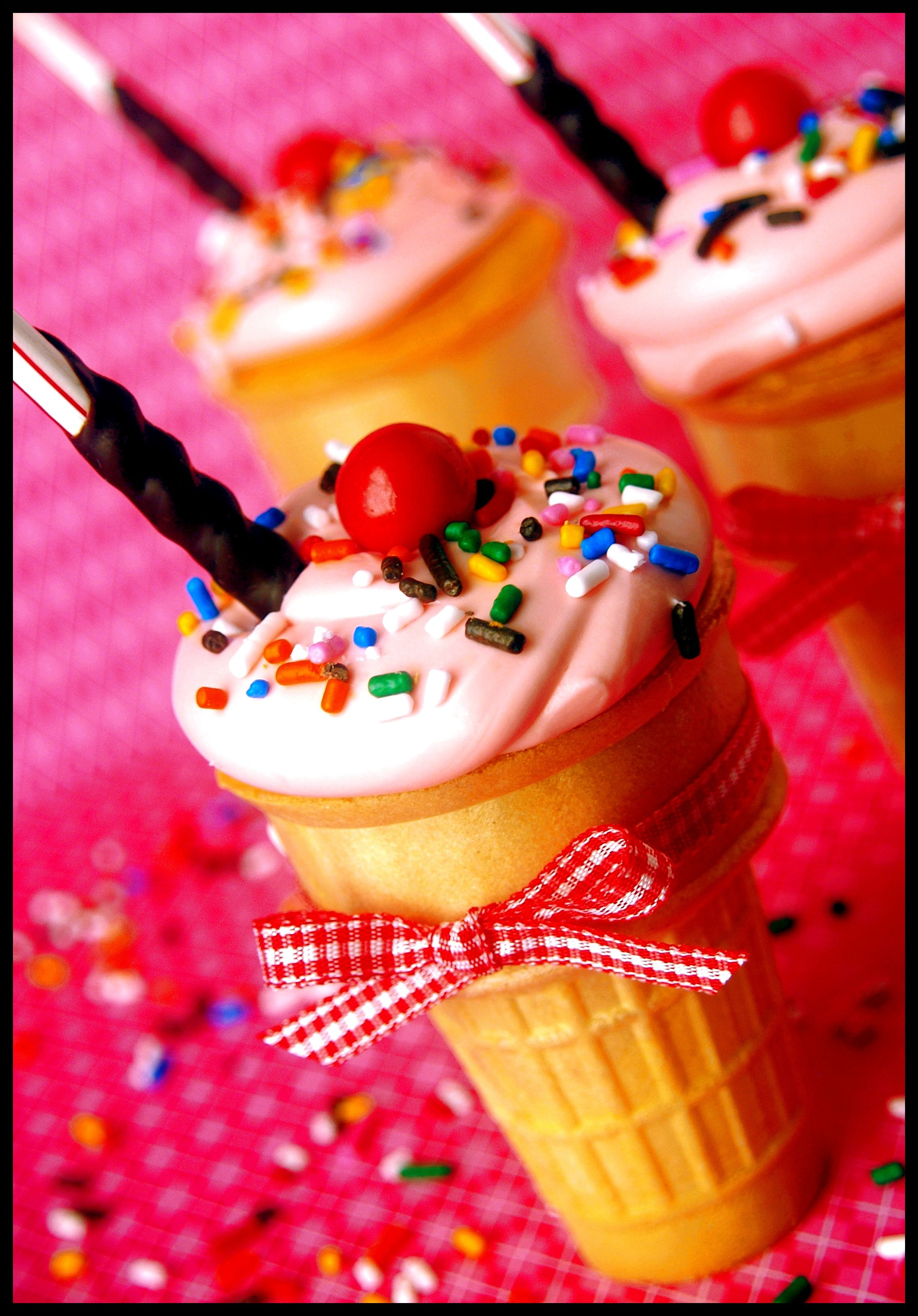 These are too cute! cake in an ice cream cone...why not top it with ice cream?  then you can have both in one shot!