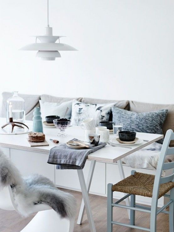 Love the built in bench with the white table and mixed chairs in