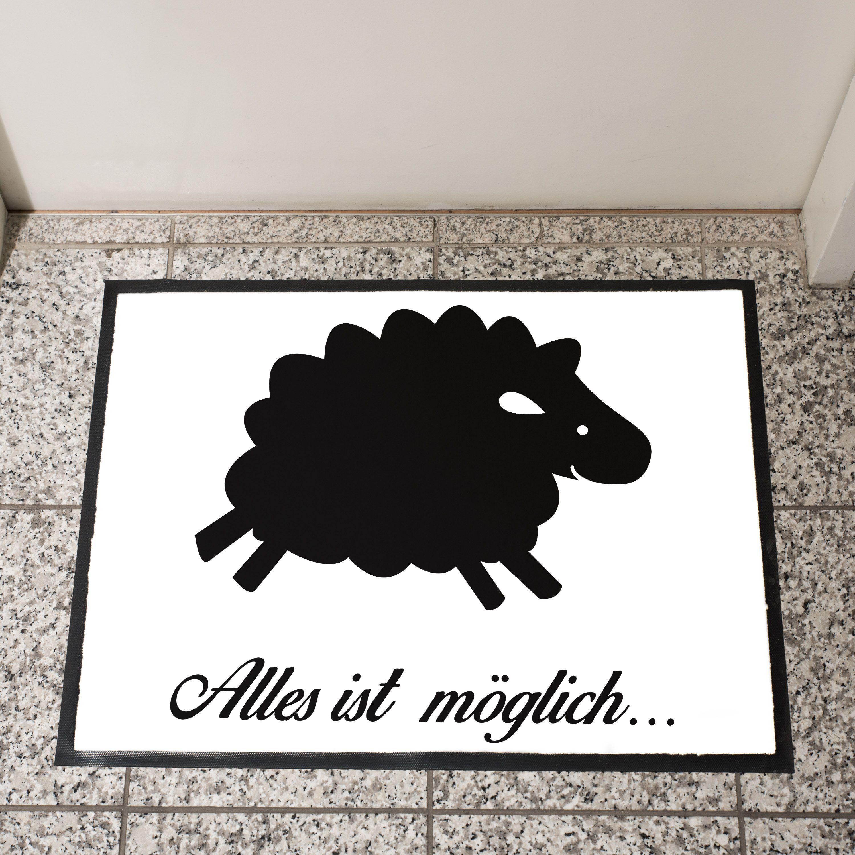 Fußmatte Schaf aus Velour  Schwarz - Das Original von Mr. & Mrs. Panda.  Die wunderschönen Fussmatten von Mr. & Mrs. Panda sind etwas ganz besonderes. Alle Motive werden von uns entworfen und jede Fussmatte wird von uns in unserer Manufaktur selbst bedruckt und liebevoll an euch verschickt. Die Grösse der Fussmatte beträgt 60cm x 40cm.    Über unser Motiv Schaf  Schafe gehören zu den ältesten Haustieren der Welt und sind für ihre flauschige Wolle bekannt. Schafe und ihre Lämmer sehen durch…