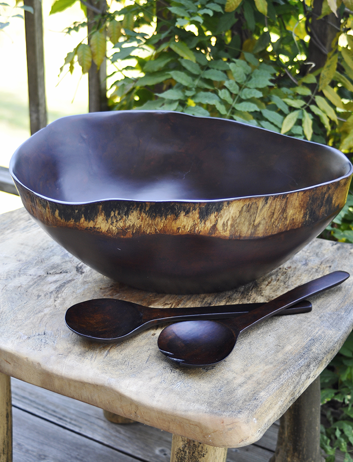 "This visually stunning, limited edition bowl is one of Einstein Albert's most sought-after pieces. The 15"" wide bowl is hand-carved into an organic shape from a single piece of obeche wood, a sustainable tree grown on Albert's second-generation plantation outside Port-au-Prince.  http://www.swahilimodern.com/products/einstein-albert-rustic-obeche-bowl-with-servers"