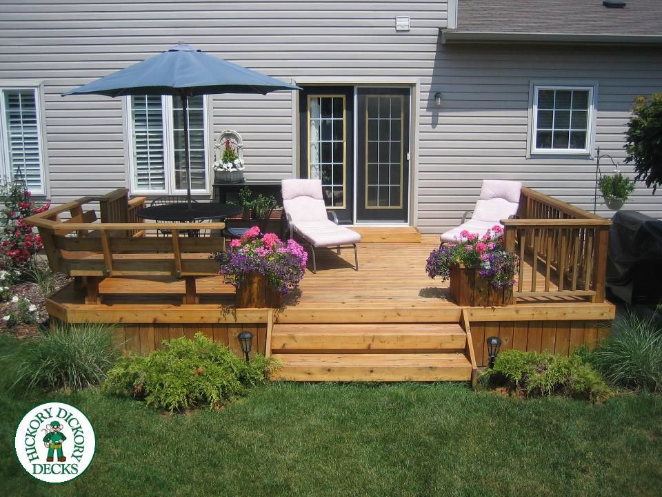 Attached benches and classic railing for low deck. Small
