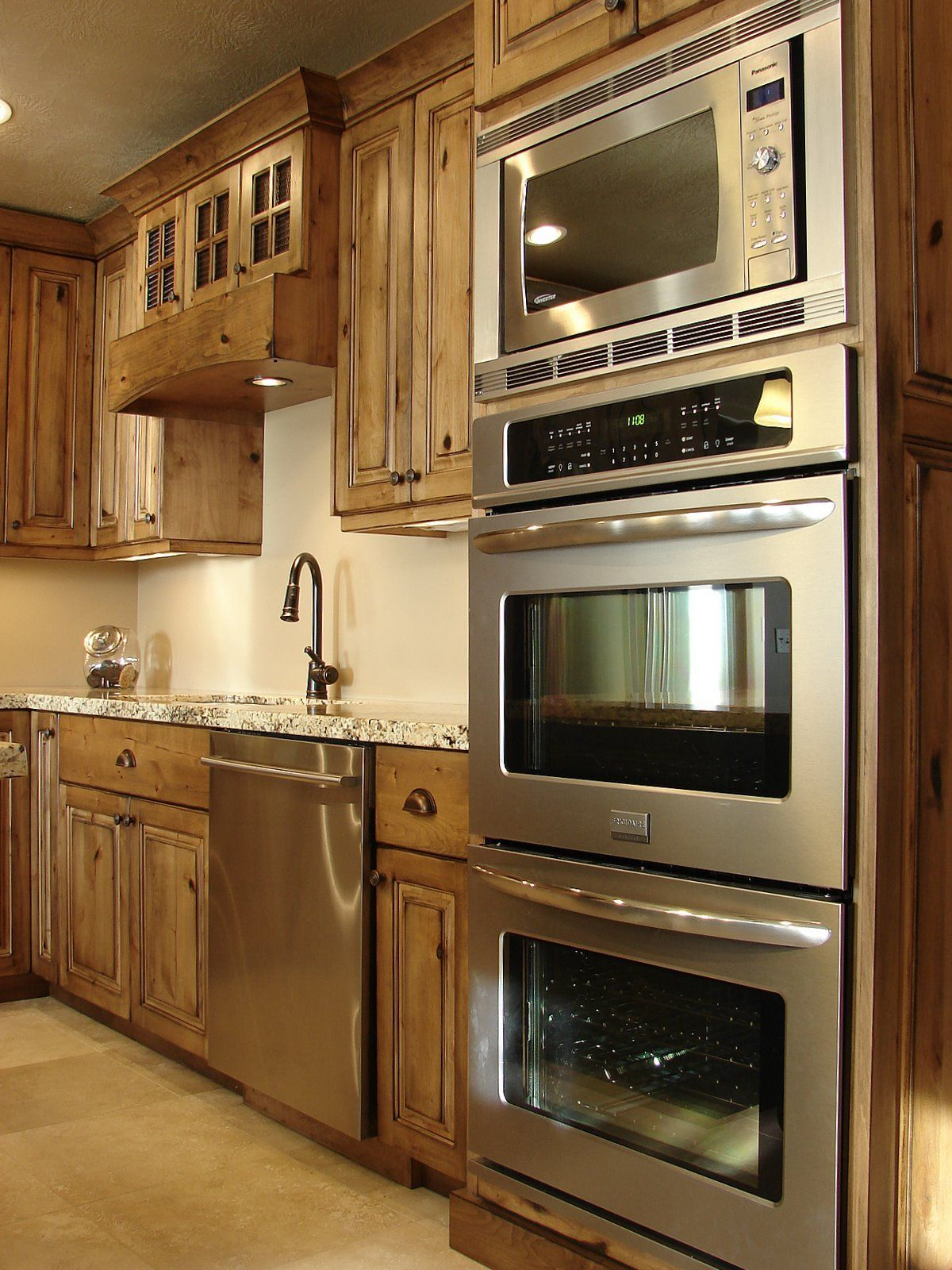 double oven and microwave and alder kitchen cabinets