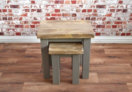 This beautiful nest of two tables feature chunky rustic hardwood