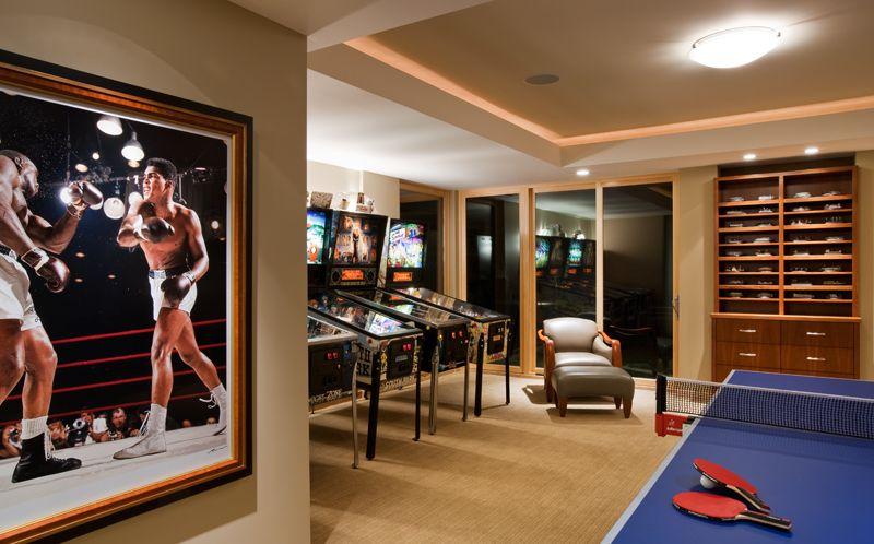 Pinball and table tennis room Neil Leifer photo of Clay Ali