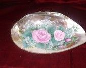 Hand painted pink roses on a sea shell.  Would be great in the bath as a ring holder or soap dish.