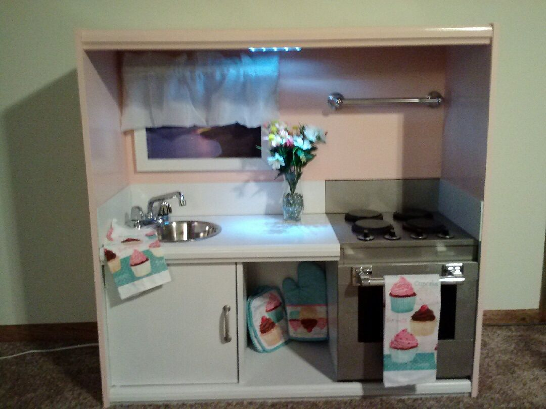 Diy Kids Play Kitchen Made From An Old Entertainment Center Childrens Play Kitchen Diy Play Kitchen Kids Play Kitchen