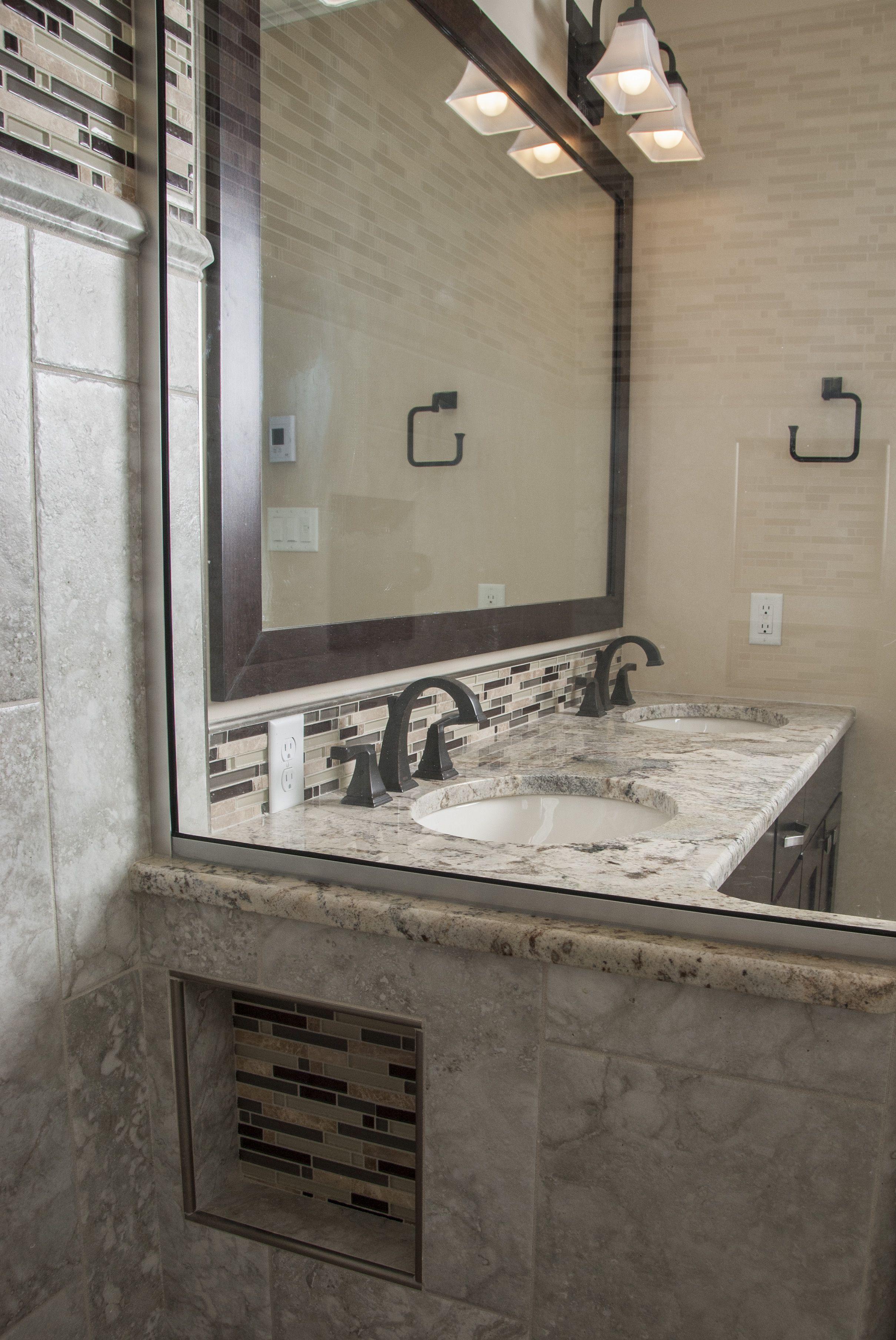 glass shower custom vanity granite countertop espresso mirror frame mosaic tiles hidden niche shower niche oil rubbed bronze faucets