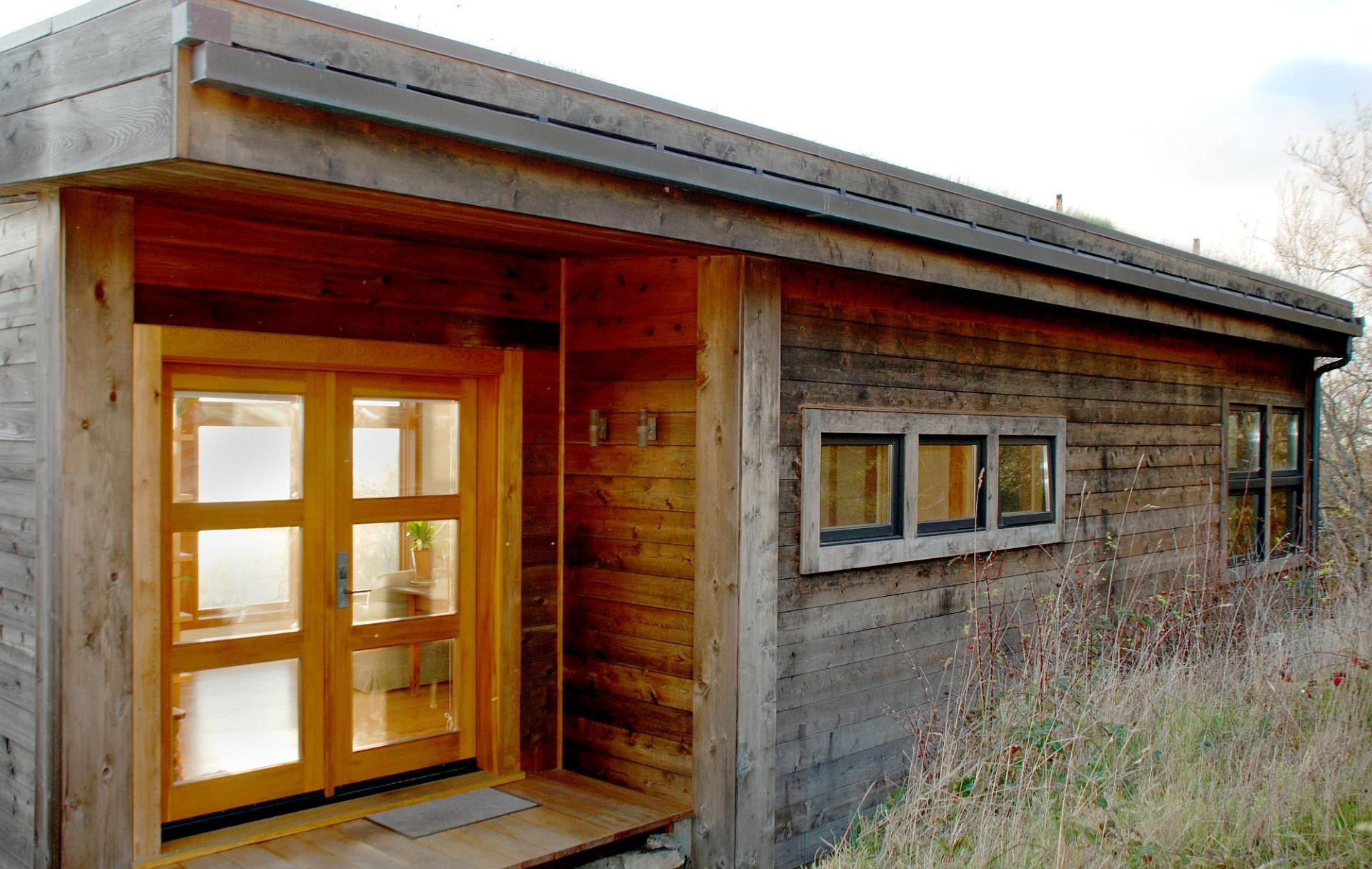 with a sod roof and weathered cedar siding eagle point cabin blends