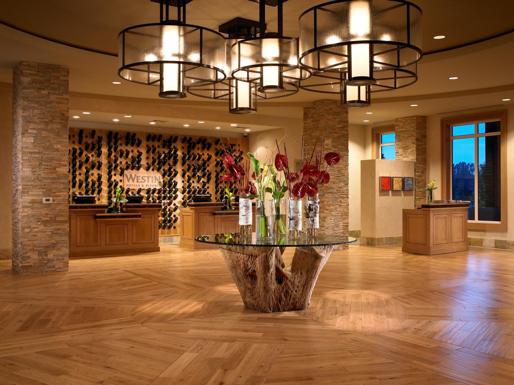 westin napa lobby reception - Wine bottle art wall behind front ...