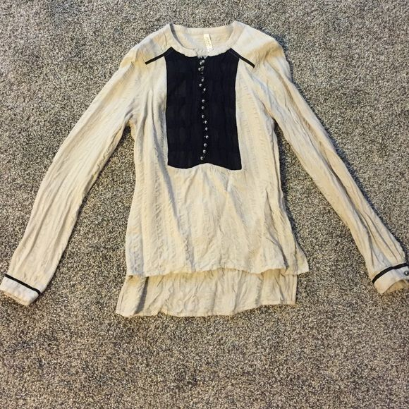 Free people long sleeve shirt Cream colored long sleeve shirt, half button up that fits very well. Free People Tops Tees - Long Sleeve